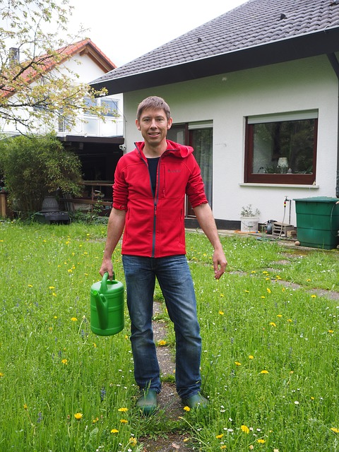 Gardener with watering can